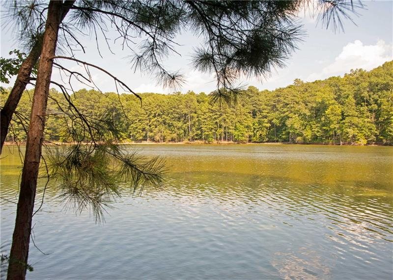 Beautiful, walkable wooded 4.87 acres directly on Lake Allatoona. Only 1.5 miles (4 mins) to Little River Marina. Public water, sewer, electricity. Convenient to Bells Ferry Rd and I-575. Perfect for building your new lake home. Plenty of room, with all of the property usable. A rare find!