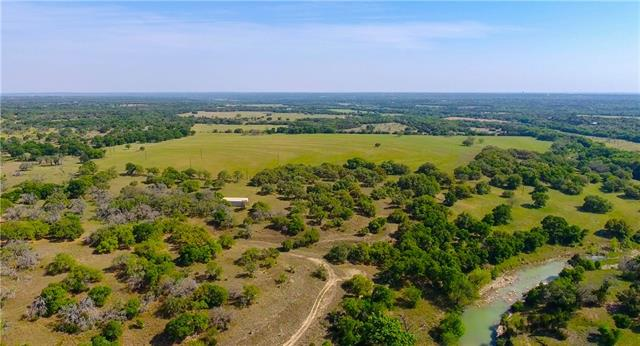 Available for the first time in over 100 years, this is a rare opportunity to own a beautiful live water ranch in one of the states fastest growing areas. The 239.53 acre Burkett family ranch is located just north of Liberty Hill, TX on the North Fork of the San Gabriel River.  A combination of cross-fenced native and improved pastures provides feed for the resident Black Angus cattle herd and forage for a productive hay operation. Abundant wildlife and recreation, three water wells, minerals covey.