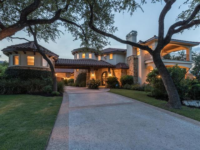 Fabulous home in the heart of Lakeway w/elegant double iron doors. Cascading stone waterfall in entry way. Master & Guest suite downstairs. Large Master glass block shower opens to private garden. Large living area w/ wall of windows opens to backyard & swimming pool w/ water feature. Great home for entertaining friends & family. Media, wet bar & gameroom upstairs w/ fireplace. Lake Travis & Hill Country views from 2nd floor & deck. Walk to Lakeway Park. No HOA dues