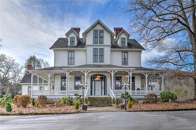 Civil war era Victorian home on 4.6 acres. The stately entry features 12 ft ceilings, magnificent arch woodwork and grand staircase. Heart pine wood floors add charm to this 1860's home. Includes old carriage house and rock building. Hendersonville Racquet club with tennis, racquetball, pool, exercise, etc. adjoins property. Convenient to downtown and Laurel Park shopping. Numerous potential development and commercial uses such as a Bed and Breakfast. Past lease income history available.