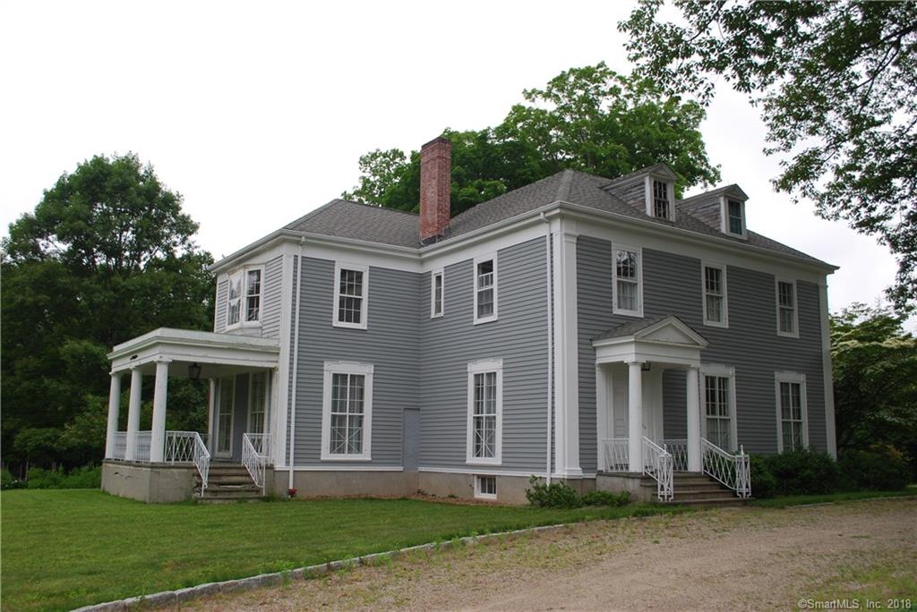 An exceptional opportunity to invest in this nearly 5,000 sq. ft. Greek Revival that is being offered for the first time in the past 42 years!!  Set on two gorgeous acres with circular drive in the heart of Ridgefield's most prestigious location.  This offering is surrounded by multi-million dollar properties, the values of which would support any potential renovations.  This is an opportunity to bring a classic 1885 residence back to its original grandeur.
