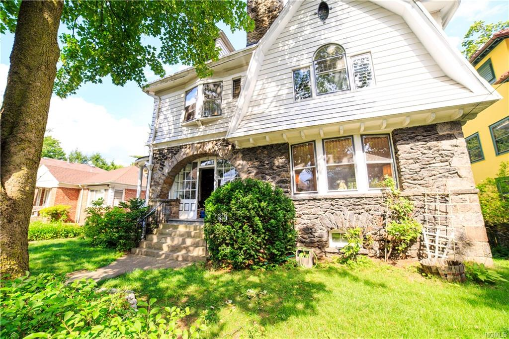 Live less than 15 miles to NYC in the beautiful, sought out Park Hill area of Yonkers in an true colonial home. During the turn of the century (1900s) residents lived in this area to be close to NYC. It is a restoration dream come true! This home has been well-maintained since the Bottali family bought it in 1953. With a customized stone archway, covered porch in the front, original stained glass windows throughout, along with a balcony on the first and second floor it is nothing like the typical homes on the market. The architecture from the early 1900's can not be replicated in any fashion, designed with grandeur. The first floor is designed for entertaining, with a formal dining, living area and fireplace, featuring hardwood floors. The bedrooms are located on the second and third floor, with potential to customize to your own liking. Original siding was cedar, the present aluminum siding with insulation underneath, it was done in the early 60's.