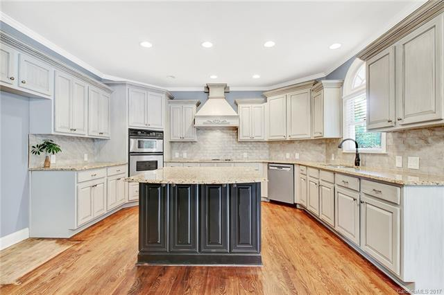 Move-in ready home in Bridgehampton with major attention to detail in the upgrades!  This majestic home features upgraded kitchen, custom cabinetry and built-ins throughout, bedroom on main, multiple storage options, and 3rd floor bonus room with office/craft station.  Outdoor entertaining space is a dream and includes covered trex decking porch, as well as paver patio with fireplace.
