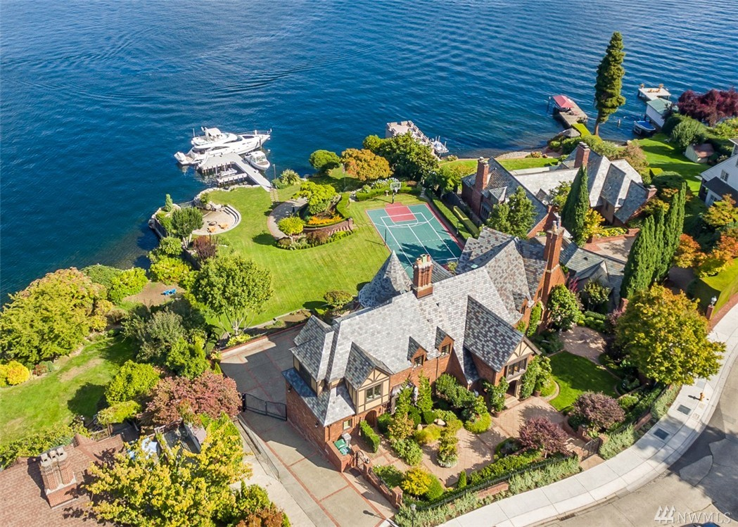 One of Laurelhurst's most notable waterfront estates, this landmark home is prominently sited on a shy acre with 175' of Lake Washington waterfront. Originally designed by noted architect Arthur Loveless. Featuring a tennis/sport court, swimming beach & dock with two boat lifts & room for a seaplane or yacht. Expansive views of the lake & The Cascade Mountains this signature residence has been lovingly restored by the present owner while preserving the period architecture of the original estate.