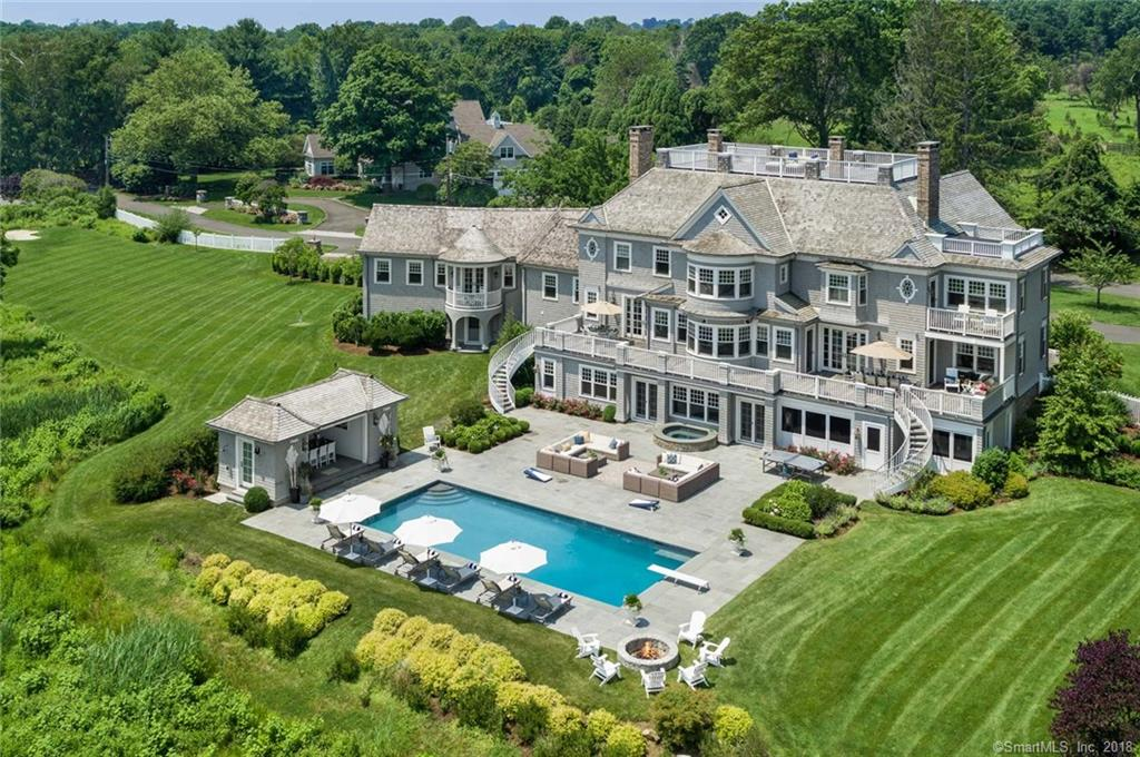 """Once in a lifetime opportunity to own a 7 acre Nantucket style estate with unobstructed views of the Long Island Sound. This  warm residence offers a lucky family the chance to live where they would vacation. This architecturally dramatic home, designed by Franzen Associates, features views from every room in the house. The arched entryway frames the sweeping water views & gourmet kitchen's focal point is the bay of windows showcasing the water scenes. As the center of the home, the large kitchen is an ideal gathering spot and the thoughtfully planned layout allows one to relax in the family room w/a wood-burning fireplace & simply move on to the veranda for an afternoon cocktail. Entertain over 24 guests in the dining room while taking in the beauty of the nature preserve. Home office w/custom-built mahogany cabinetry, private wing w/water views from both en-suite bedrooms, full kitchen, a sitting area & balcony. Master suite w/views from every window, fireplace, private balcony, spectacular walk-in closet w/custom cabinetry and a thoughtfully designed island. Breathtaking 935 square foot roof top deck - enjoy dazzling 4th of July firework displays! Elevator to the ground level w/ large family recreation room, gym, bedroom, full bath, powder room, expansive screened porch, optional wine cellar. Bluestone patio, a 20'x45' pool, open air pool house w/ 65"""" flat screen TV,  ProLinks par three golf hole w/ a professional sand trap. Private 3-acre pond w/ cedar dock."""
