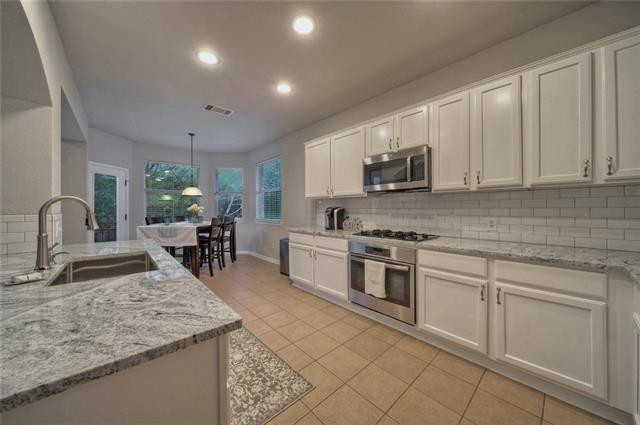 This amazing house is a BLANK CANVAS for the new home buyer - Kitchen: recently renovated with gorgeous granite, painted cabinets - Fresh paint throughout the home - Carpet installed first of March 2018.  Lot backs to private wooded green belt, perfect for the evenings to sit outside and enjoy the view. This is truly a must see!