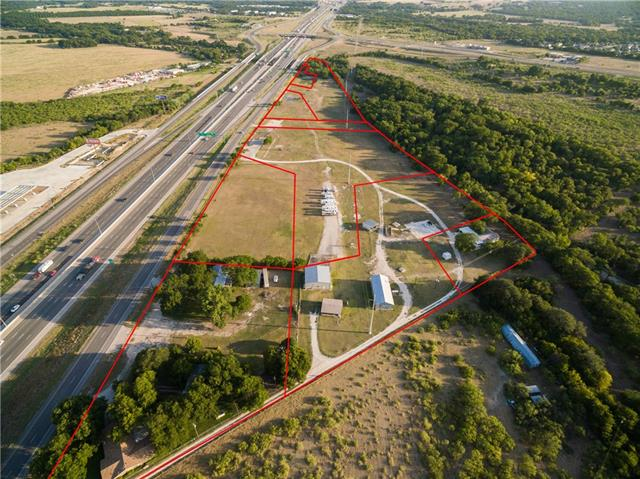 Already platted & divided 1.77 acres of: Approx 22.6 Acres located within Georgetown City Limits! 1,500 ft of IH-35 Frontage and 5 existing Curb Cuts! The property can be sold in smaller parcels as well - 9 unique legal descriptions/already divided!!! The property includes: 2 warehouses and 2 homes which could be converted into offices. The warehouses are: 30x70 and 48x48 with a FFA approved runway. Right now zoned for Ag but best use Industrial. Great potential for RV & Storage or Industrial use.