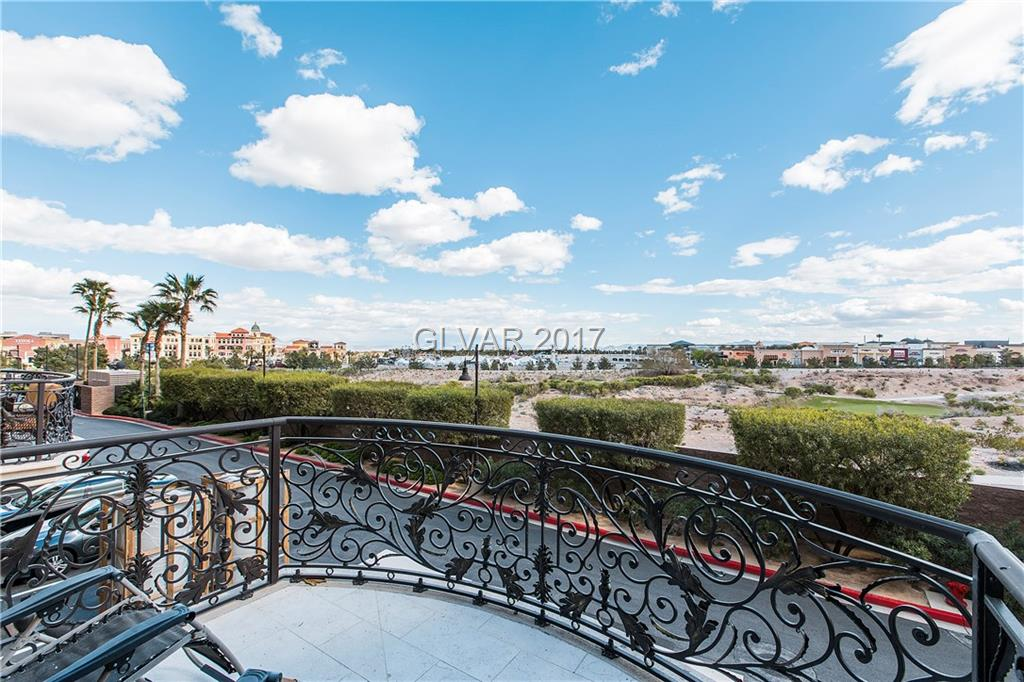 Astonishing highly upgraded Terrace unit in One Queensridge Place.  Light and airy with stone flooring, upgraded white cabinets with Viking stainless steel appliances. Luxury living at it's finest!