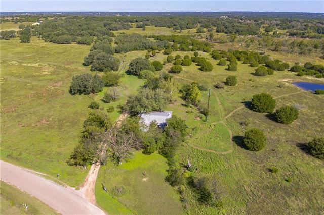 10 acres and farmhouse located just South of Bertram with trees, a pond (tank), barn and privacy galore! The updated and farmhouse has 3 bedrooms and an open (sunken) living area with a wood burning stove.  The Kitchen is finished with Saltillo tile and looks out to the hill country and neighboring fields. The master has ample space and a huge walk in closet. Current under Ag valuation, fenced, LOW TAXES and NO KNOWN RESTRICTIONS