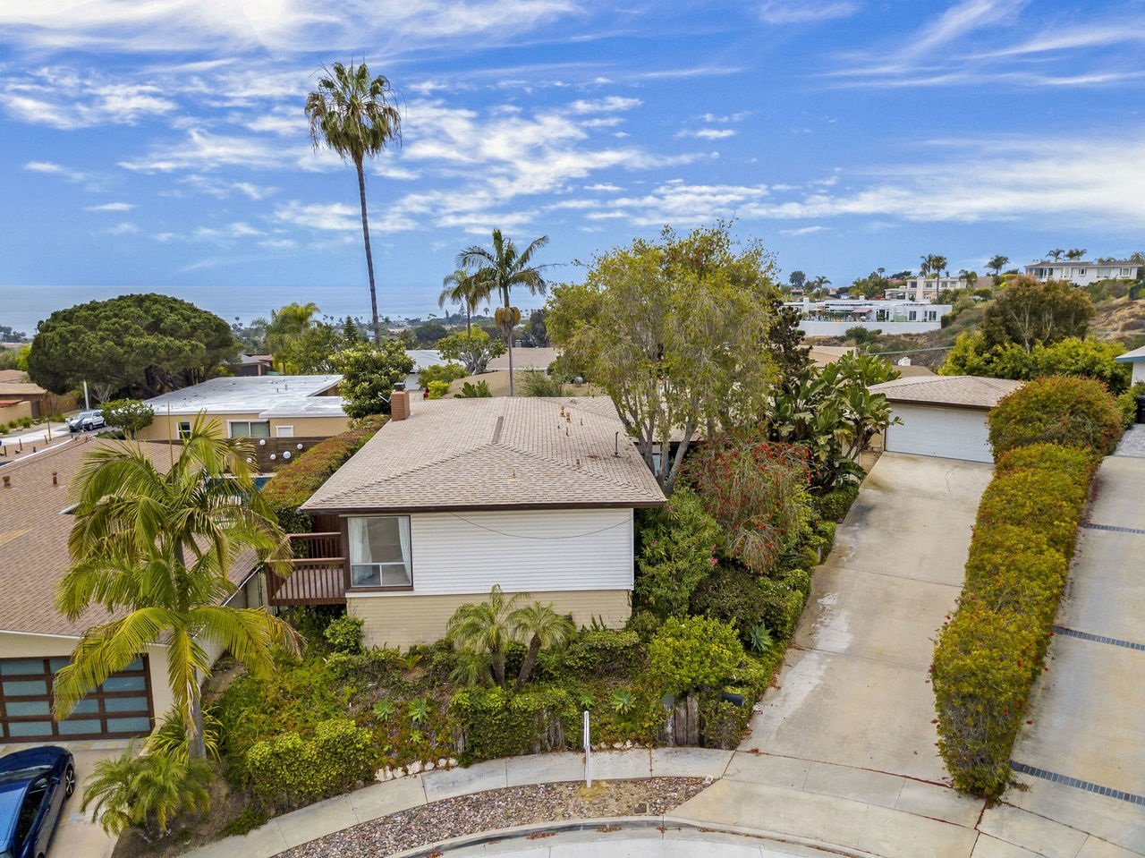 Incredible OCEAN & BAY VIEWS in this highly coveted Pacific Beach neighborhood. Located at the top of a cul-de-sac this location is quiet and private. The open floor plan is ideal for entertaining with an indoor/outdoor flow. Enjoy mature landscaping and a pie shaped lot creating spacious outdoor space. Take in the bay and ocean views from the family room, kitchen, master bedroom, and backyard. The living room has a separate entrance ideal for an office or in-law suite. This won't last long!