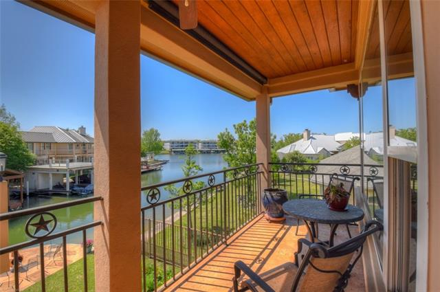 Pristine cove waterfront on controlled level Lake LBJ. Beautiful lake views from both levels.  Master bedroom and master bath, kitchen, living room, dining room, powder bath and laundry room are on the ground level.  Upstairs features a huge game room, wet bar with wine refrigerator, and 3 more bedrooms, including a 2nd master suite, and 2 bathrooms. Three covered outdoor living areas, including large covered deck over boathouse, plus a lakeside patio. Boat, furniture, and furnishings are negotiable.