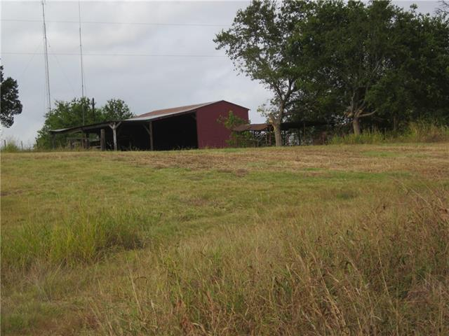 Awesome location for a rural residence in a quite & pristine area ( 109+/- acres). The tract offers income from cash rent on the row crop land ( 89+/- acres ) plus pasture for livestock ( horses ) & an area for vegetable production and/or orchard. Tract has Yankee Branch running thru the eastern part as a water feature plus a stock tank. House on property is a tear down. There is a water well on property, but Seller recommends Buyer secure a Jonah SUD water meter. Easements : Atmos Energy & TP&L.