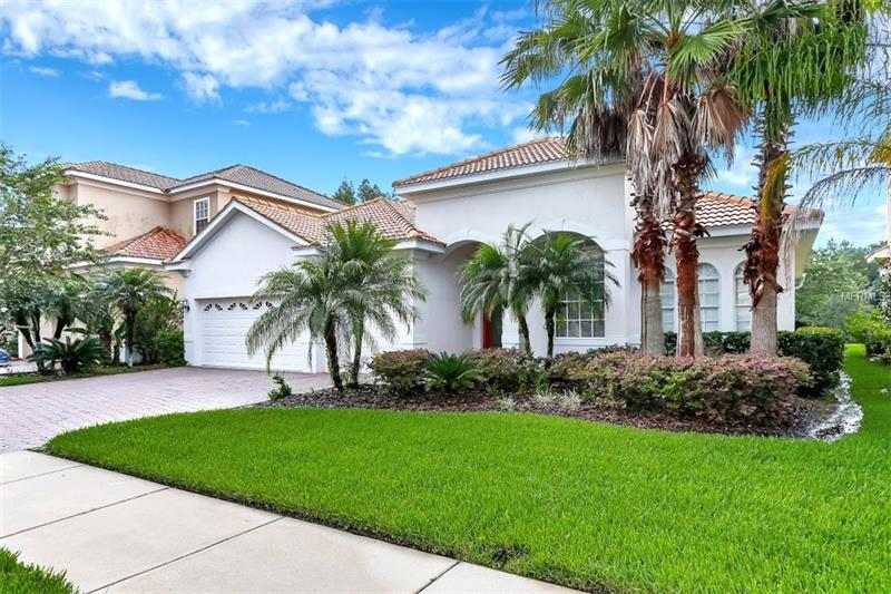 """Cory Lake Isles, the preeminent community in New Tampa! Once through the 24 hour manned gate, fall in love with brick paved streets, unique landscape, swaying palm trees and resort style amenities on your way to your island getaway.  This 5 bedroom + office + bonus room, 4 bath, 3 car Mediterranean influenced home sits on almost a 1/2 acre in the sought after """"The Point"""". Four bedrooms and three baths are on the first level with the 5th bedroom, fourth bath and bonus room upstairs, allowing your guests a private retreat. The Owner's suite has double tray ceilings, slider access to the lanai overlooking waterfront and conservation, ample closet space and private bath with all the upgrades. The other three first floor bedrooms are located on the southeast wing of the home. The large backyard can easily accommodate a pool, a large entertaining patio with outdoor kitchen or both!  Imagine yourself basking in the warm Florida sunshine, or fishing from your dock. Stunning sunsets and island views of nature await you."""