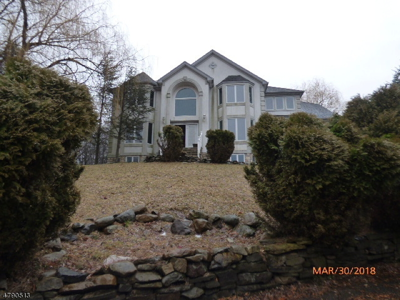 Custom Colonial with beautiful views of the Delaware Water Gap.  Custom molding throughout 1st & 2nd levels, formal living room and dining room, hardwood, tile. Kitchen has granite counters, cherry cabinets, stainless steel appliances, center island, eat in kitchen which leads to a large deck. Upstairs are 3 bedrooms and 2 loft areas. Finished lower level includes a bedroom, sitting area and kitchen and full bath.  Sold AS IS all inspections and CO are the responsibility of the buyer.