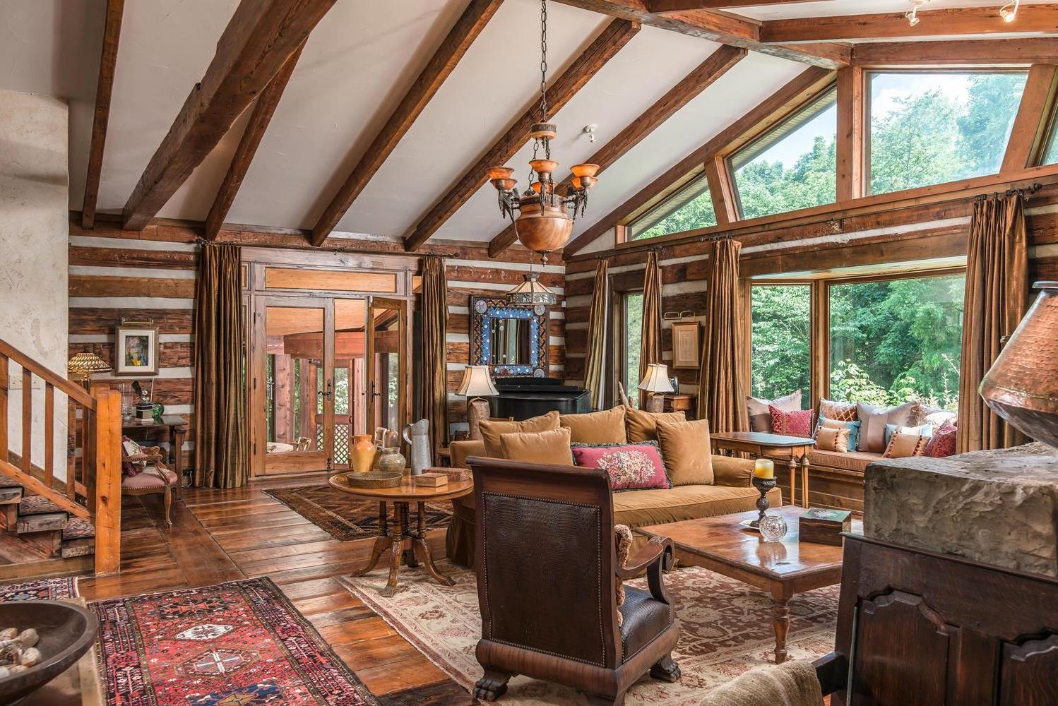 Rare spectacular hidden retreat in Davidson county.  This home is constructed from 2 civil war era log cabins, moved from Kentucky and reassembled on site.  Floors are 24in wide heart pine.  Come see this remarkable gem.  Private pool, and Bocce court. 4 acres fenced in for pets. Total of 21+ acres included with this home