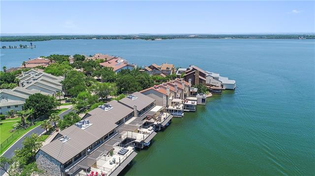 Open water updated townhome in the heart of Horseshoe Bay. Located within walking distance to the Yacht Club and the hotel. With 5 bedrooms and 4 bathrooms this townhome is about 2,696 square feet. Every floor of this unit has outdoor space, so you can enjoy the lake from every level! The property has sweeping open water views from nearly every room in the house! The lower deck allows you to jump right into the lake or spend your time fishing. Hydraulic boat lift already installed!