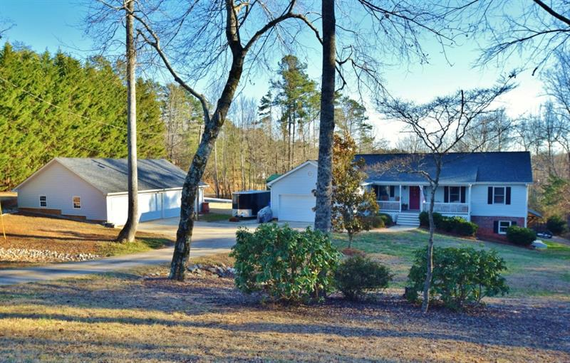 Stop right here for space to spread out! This home sits on over 2 acres and has a 2 car detached garage/workshop. Also there is a paved/covered RV parking with power hook up! So many extras! The house has an open floorplan upstairs and a completely remodeled basement - y'all - it looks like Joanna Gaines did it! 4 total beds/3 baths in a fantastic school district!