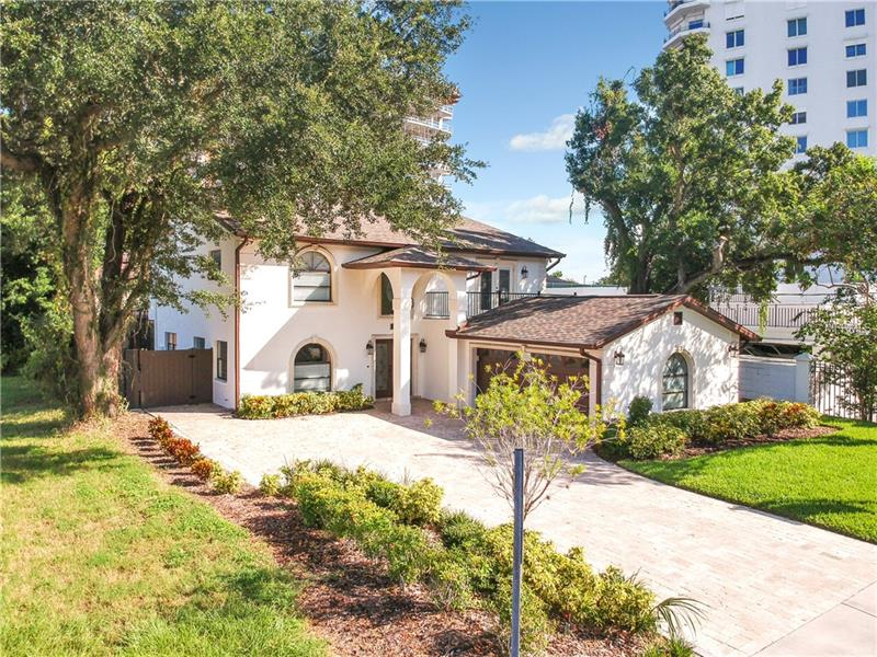 Just a stone's throw away from the famous Bayshore Boulevard. This beautiful Contemporary Mediterranean 4 bedroom 3 1/2 bath pool home, situated on charming brick-lined street only steps from favorite schools, restaurants and shops of Palma Ceia. The two car garage and large driveway provides ample parking for all your future guests. The main floor living area accommodates all your needs including formal living area, formal dining room, den, breakfast nook, adjacent large family kitchen. There is plenty of room for a relaxing, entertainment area, dining and living room includes a cozy fireplace. Upstairs you'll find the four bedrooms and three full baths. The master has the comforts of reading space, fireplace and master bath has dual vanities, spa tub, walk in shower. The backyard features a screened in gorgeous sparkling pool.This house has a brand new roof and it is NOT in Flood zone. A great entertainer's home with an unbeatable in the heart of the South Tampa location, this home has something for everyone.