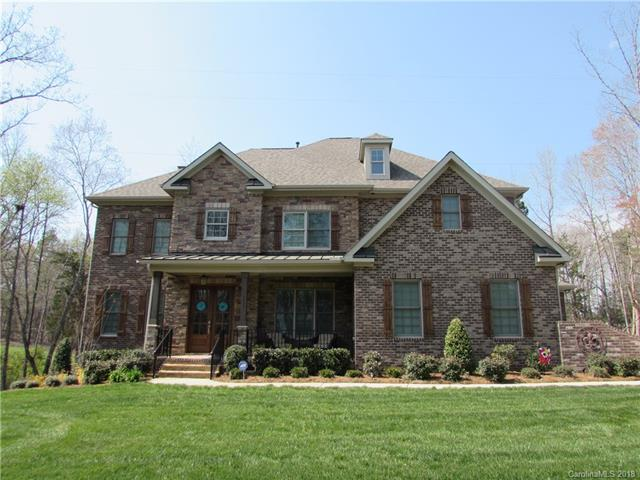 Come see this immaculate full brick home located in the desirable WEDDINGTON School District. Complete with beautiful hardwood floors and intricate crown molding and trim. Large granite island, custom walk-in pantry, and stainless steel appliances. Cozy fireplace with stone surround, spacious master suite, and beautiful tile surround showers.