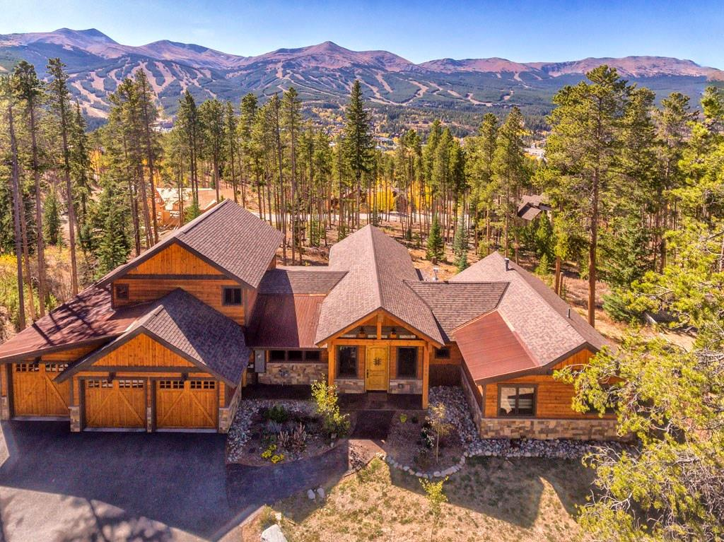 Incredible views are just the beginning! This spacious home is nestled in a serene location with huge views of Breck ski area, yet just a short walk to Main st. On just over 1/2 acre, the main level features an open kitchen, dining, & great room providing an open space for families & entertaining; master suite w/ private balcony. Upper level guest suite w/ kitchenette & deck. Lower level with family room, en-suite bedroom, office & patio walkout. Oversized 3 car garage. No 1% Breck transfer tax!