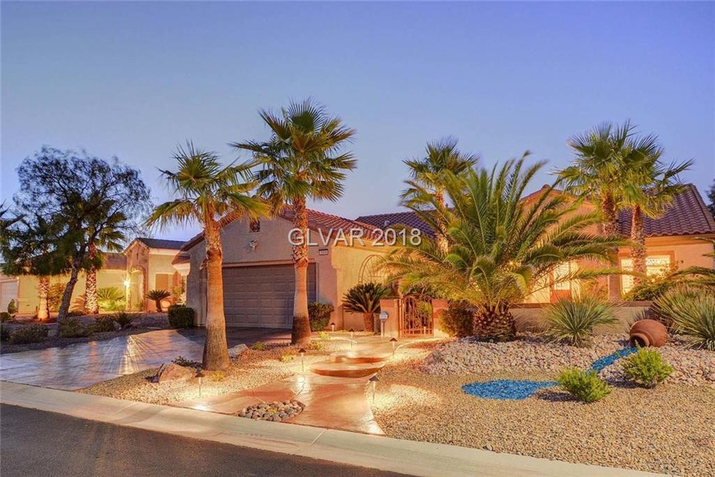 Spectacular Panoramic Unobstructed Strip,Golf & Mountain Views. Immaculate Upgraded Home in Sun City Anthem on Elevated Site w/Open Space in Front & Golf in Back for Maximum Privacy. Exquisite Finishes*Wood & Tile Floors*Granite Counters*Butlers Pantry*Stainless Appl.*Maple Cabinets*Crown Molding*Fireplace*Builtin Entertainment Center*Surround Sound*Solar Tube Skylights*Plantation Shutters*Outdoor Spa*Pond*Waterfall*Built-In BBQ & So Much More!