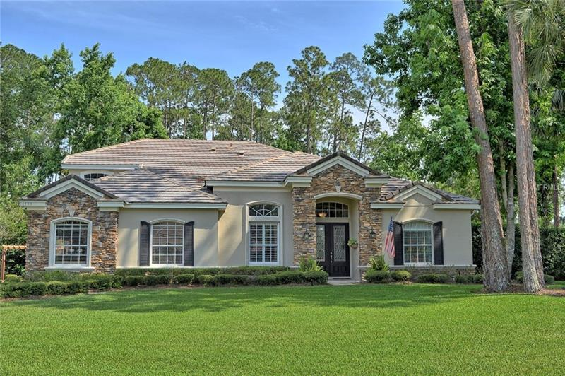 This magnificent stone accented home, complete with a private pool and spa, sitting on ½ an acre is truly a home to admire! Located in the luxury gated golf community of Magnolia Plantation in Lake Mary FL, this home has it all! The beautiful kitchen boasts an island, breakfast bar, stainless steel appliances, cherry cabinetry, granite countertops, 2 pantries and dinette which opens into the spacious family room with beautiful white French doors looking out to a stunning view of the pool! The spacious master bedroom with his and hers closets and separate dressing areas leads into a luxurious master bath with a walk-in, seamless glass shower, Whirlpool tub and double under-mounted sinks. Spacious secondary bedrooms, each with own bath and huge closets are perfect for kids, guests, or a private workspace. Formal dining room with tray ceiling is perfect for family meals or entertaining. Grand entryway, with beautiful staircase, wood floors throughout living areas and bedrooms with beautiful Italian tile in kitchen and bathrooms is the perfect touch. Enjoy relaxing under the covered lanai perfect for entertaining with a heated salt pool and spa, beautiful landscaping, perfect storage building, pergola and kids wooden play/swing set. A grand entryway, gorgeous staircase and arched doorways really make this home a must-see! Take comfort in living in the highly rated Seminole County School District, and the convenience of fine dining, shopping, and all Lake Mary has to offer!