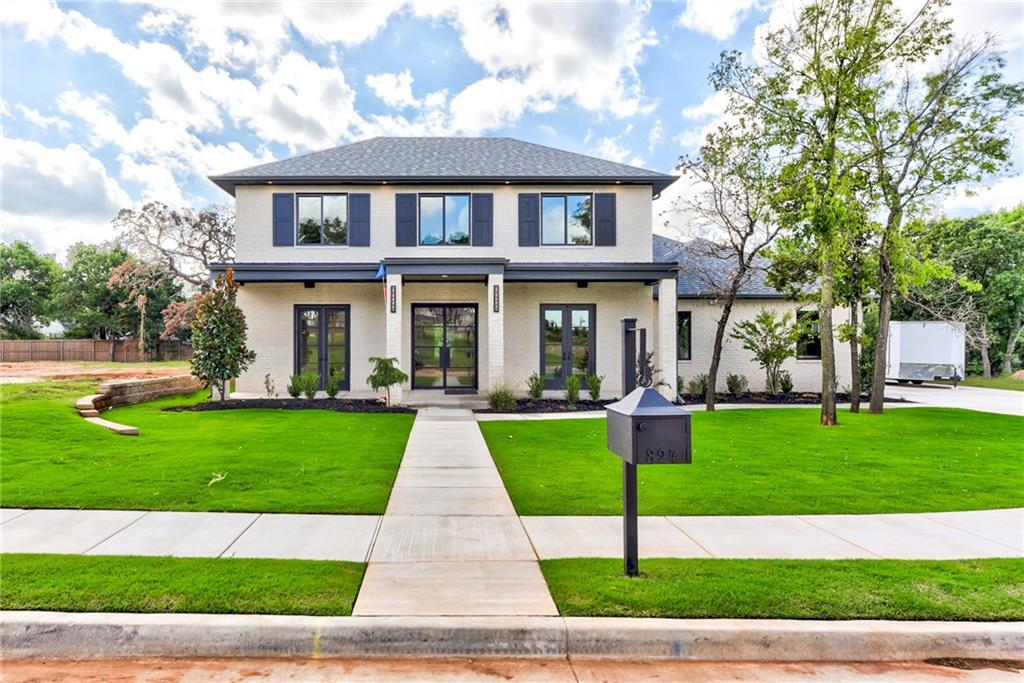 Masterful custom design and modern luxury are uniquely embodied in this 4-bedroom 4.5 bath showcase home of the 2018 Fall Classic Parade of Homes. Every detail was carefully selected and quality crafted. Beautiful hardwood floors and plenty of natural night flow throughout the home's open concept layout. Highlights include a custom designed quartz waterfall island, an elegant gas fireplace, a perfectly sophisticated study, chic recessed lighting and ceiling fans. The home's special features are what really give the atmosphere a very clean line transitional feel. Enjoy the large, covered front porch that overlooks a charming view of the park inside Turnberry at Oak Tree. Incorporating the built-in coffee maker and bar, ice maker, energy efficient elements, spacious three car garage and large open areas make it the perfect home for entertaining family and friends.