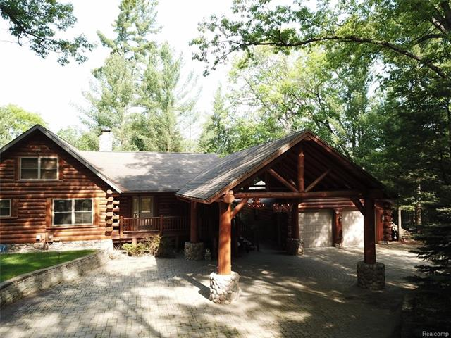 Newer Log Cabin on approximately 10 acres located on the Rifle River. Beautiful area. Very serene, wooded setting. Come see Luxury Log Living at it's best. Guest house and Pole Barn included. Pole Barn is heated with bathroom kitchen, well and septic. Main home comes with 2 wells. Over 2,000 feet of river frontage, great for fishing. Paved driveway. Easy freeway access to I-75, only 2 hours from West Bloomfield. 3.7 of the 10 acres is a buildable lot to create an extension to the property. Sale includes parcel 014-036-018-64. Come live the dream!!