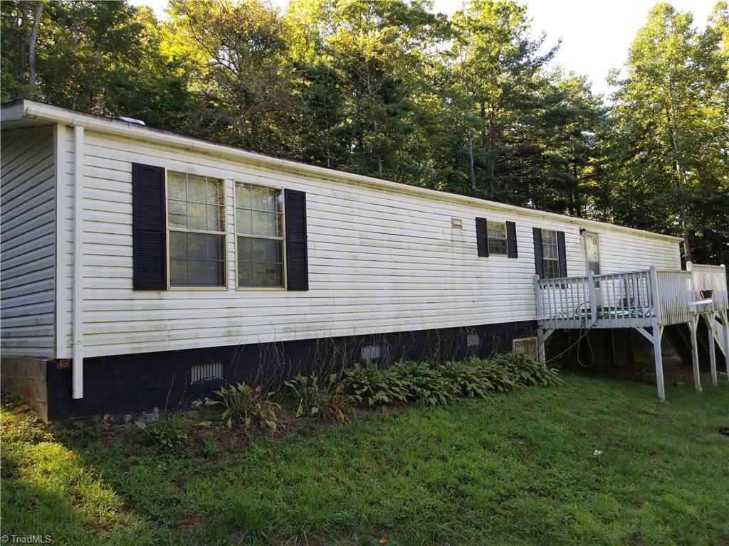 Private home on 2 acre wooded lot  with Paul's Creek bordering one side. Relax on the 17' deck and listen to the creek. Single wide home block foundation, large open living room kitchen combo. 3 bedrooms, two baths. Washer/dryer connector in hall. Great hunting or nice get a way from city life.
