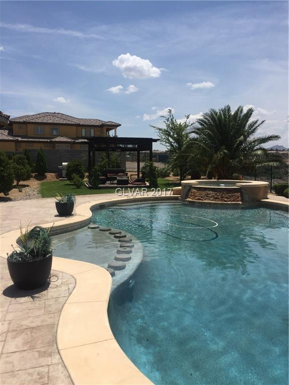 City endless views, top of Terracina Guard Gated Golf community. Priced to sell!