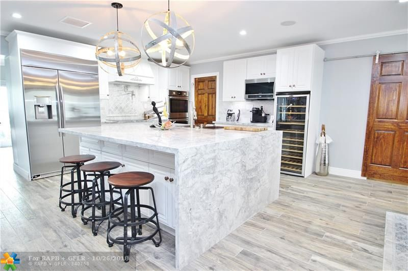 """AMAZING, COMPLETE RENOVATION from the cinder block all the way in!!...Every conceivable attention to detail has been paid on this Beautiful, Remodeled Waterfront """"Smart"""" Home. Open Concept Floor Plan perfect for Entertaining. Stunning Designer Kitchen & 3 Baths with All New Cabinetry, Fixtures & Finishes. Impact Doors & Windows throughout. Re-wired to code, even the Sewer Line under the home has been replaced. Custom Recessed Lighting & Fixtures.  Instantaneous On Demand Water Heater. New Paint In & Out. New Paver Driveway.  New HE Washer/Dryer & All Stainless Steel Appliances including Dual Ovens & Dishwashers. New Custom Fencing and Solar Lighting. Over-sized Shaded Lot.  Gated R/V - Boat Parking.  Plenty of room for a pool.  Highly sought after Wilton Manors Neighborhood."""