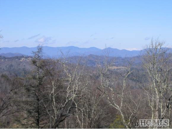 Great opportunity to build your dream home in Old Edwards Club! This 1.71 +/- acre combination lot offers incredible long range mountain and golf course views from every direction. Two lots combined with an elevation of approximately 4,400 feet and only one HOA fee.