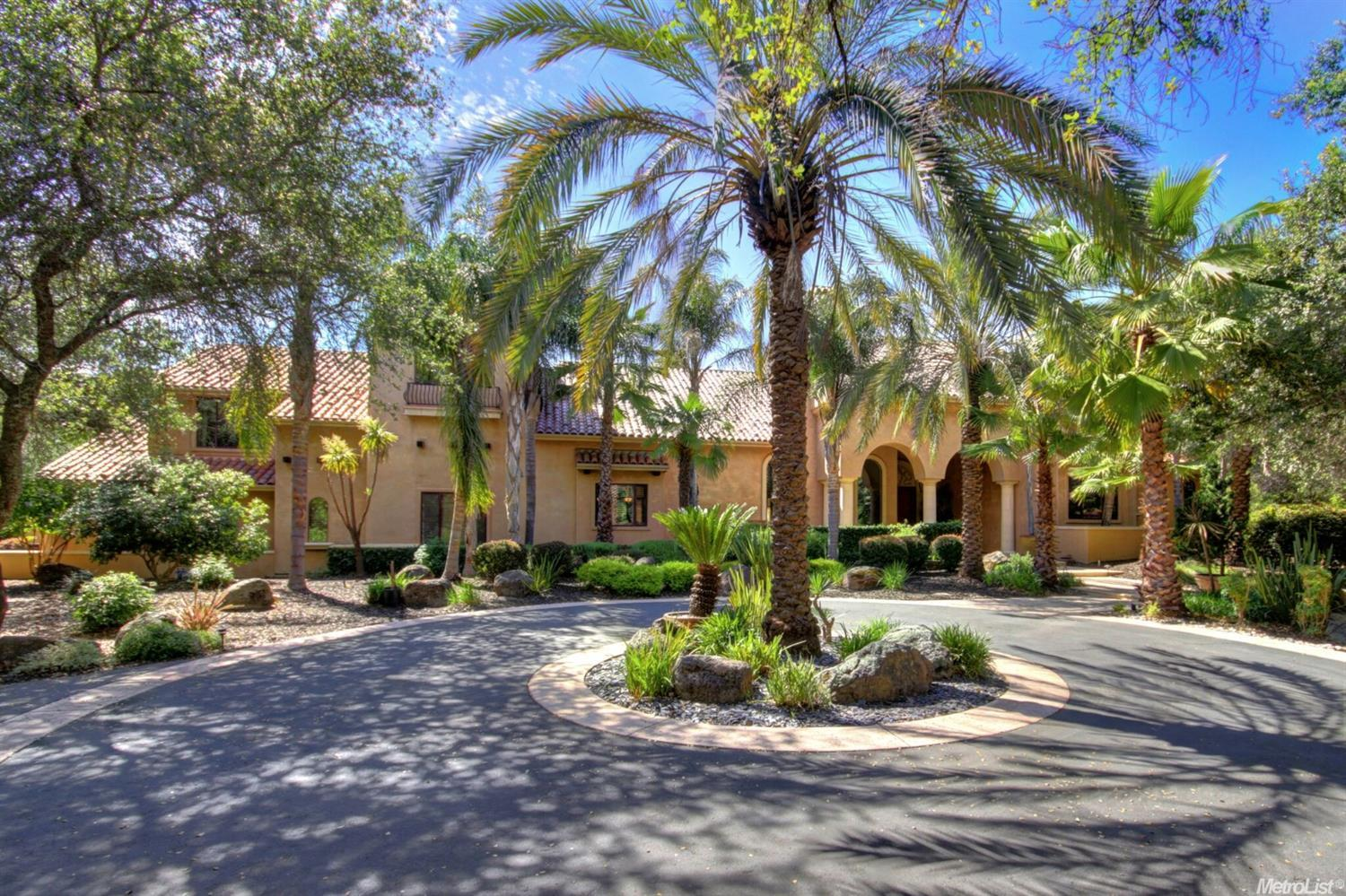 Immersed in privacy and serene natural beauty this Montecito style estate designed by Donald Joseph captivates high end detailed finishes, luxurious amenities and resort style living set on 5 beautiful acres that include a separate covered outdoor kitchen with changing room and bath that overlook the sparkling pool tennis/basketball court and batting cage.  Luxurious ground floor master suite with additional exercise room and sumptuous master bath includes steam shower. Stunning estate property.