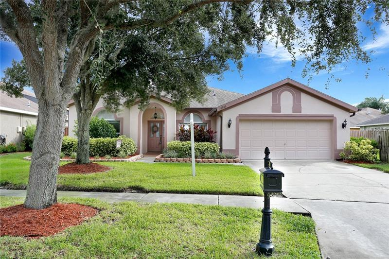 Located in Tampa's Westchase Community, updated, 3 Bdrm + Den/4th Bdrm, 2 Bath, 2 Car Garage Home features a light & bright open floorplan. You're greeted by pride of ownership that shows w/ a well manicured yard and beautiful curb appeal. Freshly Painted interior welcomes you in. Formal Dining and Living Rms provide great spaces for entertaining. Family Rm has oak hardwood flooring, is prewired for surround sound & has sliders leading to the Lanai. Kitchen was renovated in 2018 & boasts oak flooring, Cherry wood cabinets, Staron countertops, Glass & Stone backsplash, under-cabinet lighting, breakfast bar, eat-in nook & Reverse Osmosis System. Split bedroom plan provides privacy for owner's suite. Adorned with crown molding, the Master Bdrm has an en suite Bath complete with New floor tile, New light fixtures, his & hers sinks, white cabinets, soaking tub, separate shower stall, linen closet & a Huge Walk-in closet with organization system. Den makes a great 4th Bedroom with it's custom built-in Murphy Bed, desk & wardrobe.  2nd Bath was remodeled with New tile floor and light & plumbing fixtures, Cherry cabinets & Staron counters.  Spacious, fully-fenced backyard is perfect for you to add your custom pool and has natural gas line run for grill or outdoor kitchen.   New Hot Water tank in 2017 & in-wall pest tubes. Westchase amenities: 2 swim & tennis centers, golf course & country club & covered playgrounds; plus you're close to excellent schools, restaurants, shopping, Florida's finest beaches and more!