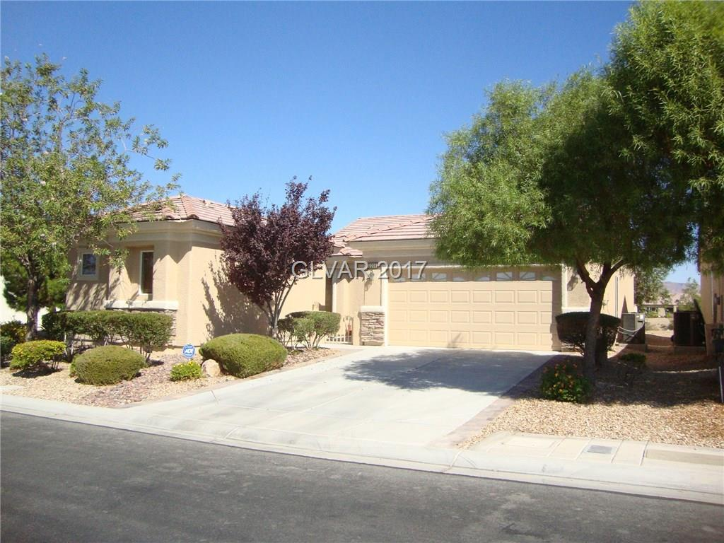 Enjoy this Laurel model Pulte single story home, two bed rooms with furnished casita, featuring golf course views in front and back as well as mountain view's. Granite counters in kitchen, new paint outside. Ceramic tile, wood-like laminate and carpet throughout. One of Aliante's finest locations.