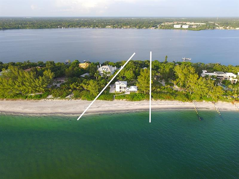 NEW PRICE! Location, Location, Location! Arrive by boat or car. North Casey Key beachfront tropical oasis. 200ft of private beach on the Gulf, 2 homes on the beach, main home on the bay w/dock & lift. Once on the estate you are amazed by the mature tropical lush botanical garden landscaping surrounding the home. Through the front doors of the 3 BR main house you have luxurious neutral marble throughout your great room, kitchen & living room. The living room overlooks the Bay, access to the pool, volume ceilings, fireplace & wet bar w/exotic finishes that are sure to WOW. In the kitchen you can enjoy top of the line appliances by Thermador while enjoying friends/family in the living room, or while gathering around the breakfast bar. The master BR is the perfect place to relax w/French door access to the pool & Bay. The master BA is adorned w/exquisite finishes. The main house has a pool & lanai w/pool cabana, outdoor shower, & Bay views. There is a large patio that extends to the private dock w/lift. Continue to the other side of the estate there's 2 guest houses both w/unobstructed views of the Gulf of Mexico for miles. The 1st guest house boasts cathedral columns on the outside, walls of glass, terrace, wet bar & elevator access to all levels, private 200 ft. beachfront & tower balcony to enjoy year-round sunsets. The 2nd guest house is perfect for overflow guests or live in help. Both the main & guest houses have oversized 2 car garages. An estate w/old world elegance. SELLER ENCOURAGES ALL OFFERS!