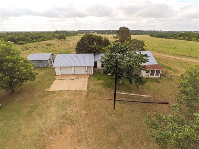Charming Country Retreat! Enjoy the Barndo style Guest House, while renovating the Main House! Property features a scenic stock pond when you enter the property, and has great views of pastures and woods! Come explore the possibilities!!