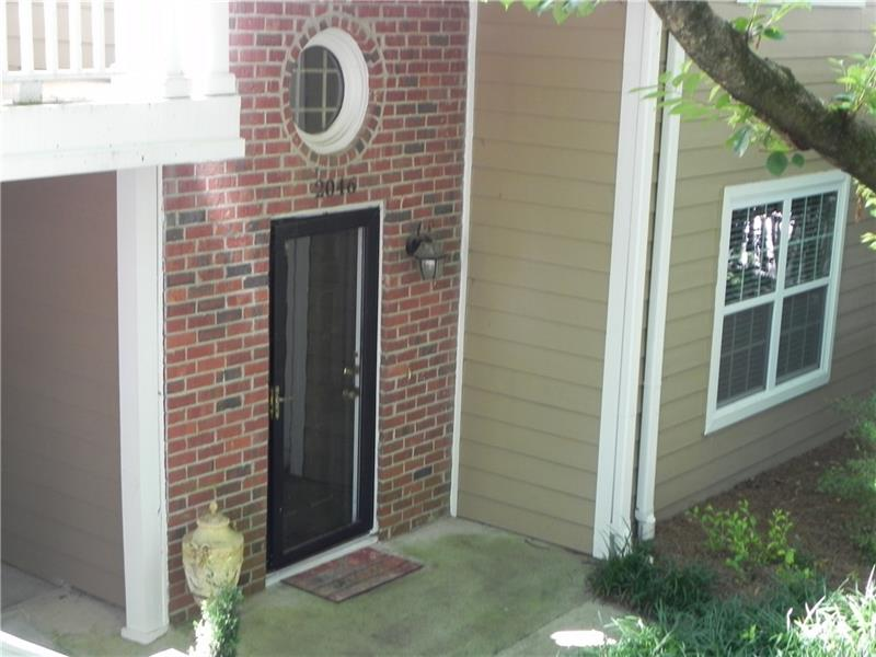 AMAZING DEAL FOR BEST EAST COBB SCHOOLS! Move right in to this spacious 2 bed 1 full bath. Located right near the Chattahoochee River you can enjoy walking, biking, running or just have a picnic. Home has a very private great view of nature. The community has swim and tennis. Home also has  newer carpeting and neutral colors, spacious family room with a fireplace, renovated bathroom with a jetted tub, master bedroom has a ceiling fan and walk-in closet. Kitchen has white cabinets, gas range,refrigerator, tile floor, dining area.  Super close to 285 and 400!
