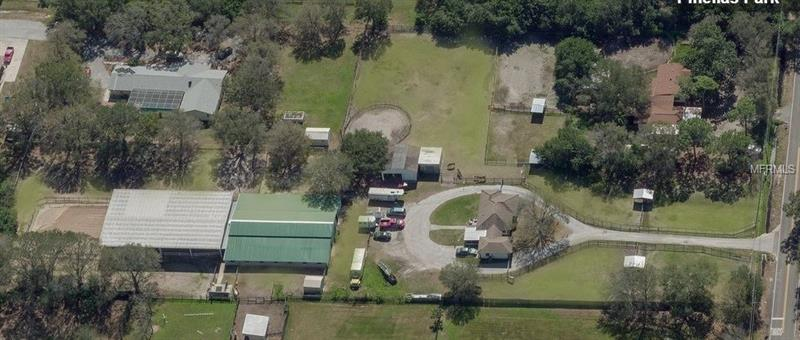 Immediate income of just over $5K per month. Pinellas Park Horse Farm, just over 3 acres and grandfathered in for appx 24 horses! Close to Pinellas County Gulf front beaches and just a short horseback ride to Pinellas Park Equestrian Center. This ranch has a grain barn, office, 2 tack rooms and a huge boarder's lounge with a large window looking out under a covered arena with flex fencing for the arena. Total of 21 stalls and was fully renovated in 2010 and recently added it's own private bathroom. New roof in 2002 and 2nd part in 2004. There are a total of 11 paddocks with a large riding field. This property also has a 2 roll door tractor garage and 2 hay barns. There is no climb in place on all fencing with French drains in each paddock and double pasture walk unders. Located in the heart of Pinellas Park Equestrian community, this property is also located in a no flood zone X. The home on this property was rehabbed to suit the farms needs in 2010 and is a 3/1/1 with a completely replaced HVAC system in 2010. It's adorable with original wood flooring and cozy nooks and crannys. Public and Private utilities with new well in 2015. Ask for detailed highlight sheet (also attached in MLS) There may be commercial potential as well. Rezoning, if possible, could offer multi family use/ income and is up to the Buyer to verify all use of residential, multifamily and farm and ranch potential. Come and see!!