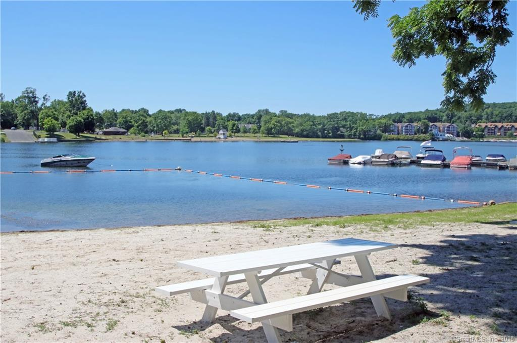 Hello Candlewood Lake! You've been waiting for this…rare opportunity to enjoy Connecticut's most popular lake for a mere $75 a year! Optional association membership provides private beach rights located on Boat Road, just down the street. Looking for a boat slip? Yes! $1,000 for the first year and $550 thereafter- based on availability. Located in the heart of Pleasant Acres Association, 2 Wondy Way offers a solidly built and well maintained 4 bedroom, 2  full-bath single-level home.  Bring your ideas and make it your own or move right in- summer is here! Enjoy lazy days on the large, awning covered deck- lake views can be seen through the tree canopy. Looking for a private, level lawn? It's here with mature landscaping and seasonal perennials. A well-built handicap ramp offers easy access for all, connecting the paved driveway and 2 bay garage to the house. Step inside to the spacious family room- hardwood floors flow throughout, preserved with carpet through the years. Master bedroom has a deep closet with extra storage- just around the corner is the updated master bath with a step-in shower and laundry closet. Easy living is the name of the game here! Quiet neighborhood setting close to restaurants, shopping, schools, commuter corridors and an easy 90 minutes to NYC.