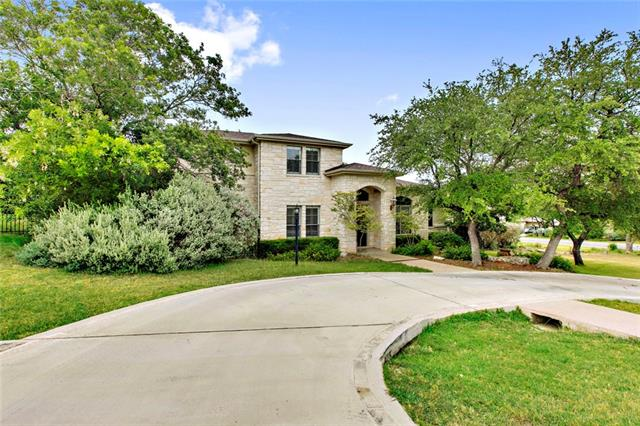 Stunning limestone on corner lot with circle drive in walking distance from City Park + minutes from Lake Travis! Spacious open floor plan perfect for entertaining features sunroom, bonus room up w/ covered balcony + kitchen w/ large island and breakfast bar open to family room. Relax in luxurious master bedroom w/ tray ceiling, wood floors, walk-in shower + jetted garden tub! Enjoy the outdoors from private backyard in quiet Lakeway community. All just min from Hill Country Galleria!