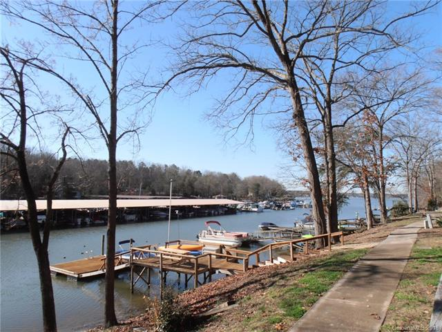 Waterfront townhouse with shared Dock on beautiful Lake Wylie, 3 bed/3bth, updated kitchen in 2017,HVAC approx. 1 year new, new roof in 2012, large great room with fireplace, features include a shared dock and a year around view of the lake and marina, balcony off the master bedroom, main floor has a large deck that allows for a breathtaking view. The basement level includes a partial covered patio/deck area with fencing and all lake view oriented w/lots of outdoor living space.  Bring your boat and toys! Enjoy Lake Wylie and everything Tega Cay has to offer!
