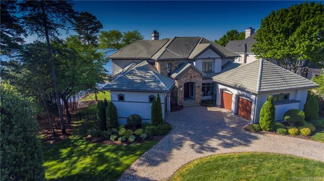 Welcome home to this one of a kind luxurious waterfront home with breathtaking lake views from a very desired southern exposure. This 3 level Simonini built home has been updated throughout. Upgrades include new hardwoods, kitchen renovation, master suite upgrade, lake level refresh, and new outdoor living including a pool/hot tub and fire pit. The custom designed kitchen has professional grade appliances and has just been upgraded with top of the line quartzite countertops. The huge main level master suite provides majestic views, outside access, and has huge closets as well as an updated master bathroom.  The lake level has 3 bedrooms as well as an entertaining area with a fireplace and wet bar. The lake level has tons of walk in storage. The private dock has just been resurfaced. Amazing views can be found in every room in the house. This home is wonderfully situated in The Peninsula near the yacht club. No home can be built to the left creating wonderful privacy and quiet elegance.