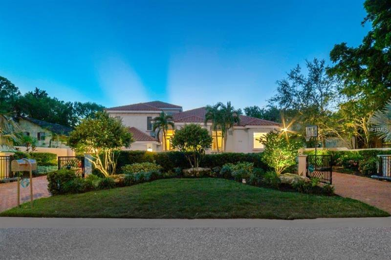All about location, all about lifestyle, all about comfort. Harbor Acres is probably the most enviable location in all of Sarasota. It's mainland living, close to downtown & the hospital, a true neighborhood, short walk to Southside village with restaurants, Morton's Market & shops. It's about this home. Luxurious in appointments with all the features today's buyer expects. The first floor owner's retreat is beyond compare with a stunning bathroom second to none, outfitted closet the size of a room plus an expansive bedroom with a wonderful sitting area. The kitchen, with a glass barn door entry is large & opens to the gracious family room. There is an over-sized one-level breakfast bar in addition to the large center island, stainless appliances, kitchen planning desk & quartz countertops. Entertaining is a pleasure at the large wet bar with a wine refrigerator & an abundance of cabinetry & glass shelving. The floor plan is flexible with a second story children's wing or guests quarters with three bedrooms (one of which is being used as a home theatre) & two baths. Amazing pool area with large spaces for entertaining including a firepit, built in seating, & dining area. The owners have thoughtfully added electronic overhead sun louvers that can be opened or closed over both the cabana-style eating area & firepit. The yard beyond the pool cage has a meandering shaded path, perfect for reading or children's play area. This home definitely has the WOW factor. This home MUST be seen to be appreciated.