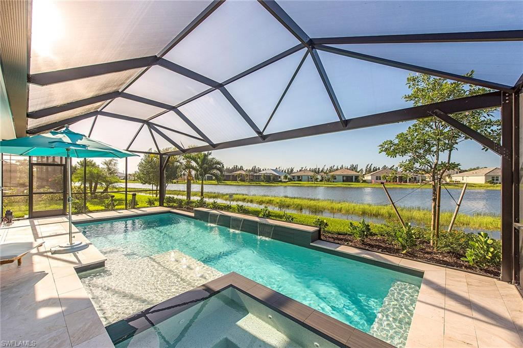 This coastal-chic retreat is located in prestigious Naples Reserve. Situated on a spacious lakefront lot, this two-story 2,528 SF award-winning Genova model home offers extraordinary water views with coveted southern exposure. Over $267k in upgrades, this newly built home (completed July 2018) includes neutral-toned porcelain tile flooring throughout main living areas. The chef's kitchen features quartz countertops, Jenn-Air appliances, concrete tile Italian backsplash, an extended island perfect for entertaining family and discerning guests. The expanded lanai has a picture window screen cage, marble flooring and a resort-style pool with three waterfalls and LED lights and a built-in spa. The master bedroom features tray ceilings, inviting recessed lighting and an upgraded shower with tile to ceiling bench and a framed shower enclosure in the master bathroom. The bonus room is located on the second level and can easily be converted to a family room or game room. Centered around a picturesque 125-acre private lake, the amenities include the new Island Club with tiki bar, café, resort-style pools. 22 lakes and nature preserves make this community breathtaking from any viewpoint.