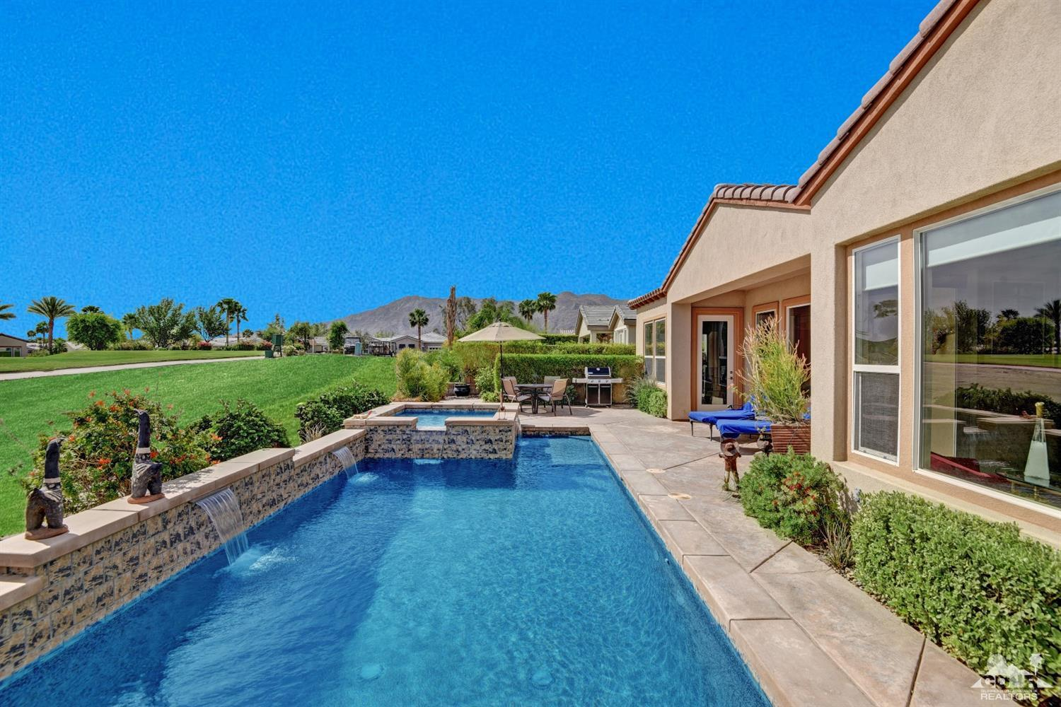 One of the best locations at Trilogy La Quinta, this Oreas model features 3BD/3BA, and pool/spa. Located on the t-box of the par 3 6th hole looking across the lagoon toward the clubhouse complex. The entry features a double-sided fireplace. Master suite features an office. Gourmet kitchen features granite counters, upgraded cabinets, and stainless appliances. Large windows allow for views to be appreciated both inside and out. Furnishings and art negotiable.