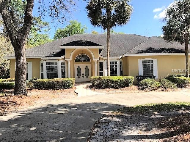 Absolutely gorgeous 5 bedroom/3 bath Jones Clayton Custom home located in the guard gated community of Alaqua. You will relish coming home to this secluded park-like setting situated on a beautifully landscaped acre lot with estate style circular driveway.  Enjoy cooking and entertaining in the spacious, open gourmet kitchen which features an island w/cooktop, walk-in pantry, & cabinetry overlaid with granite, and built-in oven and microwave. Enjoy relaxing or entertaining in the immaculate screened-in pool area which features a large covered seating area & summer kitchen. Play a round of golf on the Gary Player designed 18-hole golf course. Over 3,700 htd. sq. ft. with formal living room, enclosed dining room, family room with brick fireplace, & massive game room with wet bar.  A must see! Call today, to make this your home sweet home!