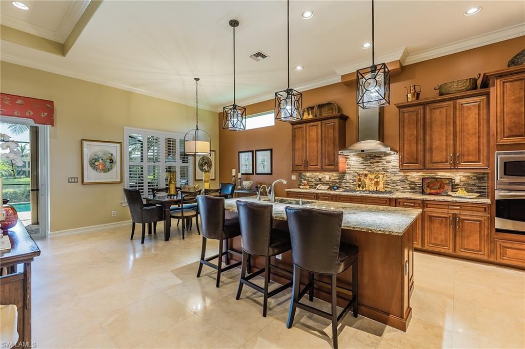 "Welcome to this beautiful ""Washington"" model in the exclusive Chiasso Village. If a meticulously maintained home, fully equipped with luxury upgrades and wide lake views is something you have been looking for, then look no further. This home boasts all of the Florida favorites such as salt water pool, open concept kitchen, upgraded window treatments, Miele dishwasher, washer and dryer, California closets throughout the home and in the garage, epoxy garage floors, outdoor kitchen and much more! For efficiency and safety, just some of the features this home includes are LED recessed lighting, natural gas generator, impact windows and doors, alarm system with video monitoring, lightning arrestor system, new three-zone air conditioner and hot water, and air-conditioned garage. A lifestyle of luxury is ensured in this residence, further enhanced by the 54,000-square-foot club and spa, full-service spa, fitness center complete with personal trainers and fitness classes, 3 swimming pools, championship golf courses, six tennis courts with 15 competitive teams, two pickleball courts, social activities, casual dining and fine dining. Optional golf, beach and marina memberships available."