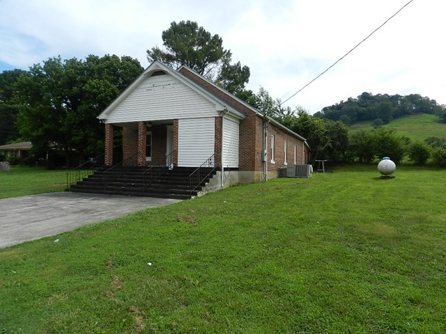 Formerly a community church but now could be converted into a residence. Its a good solid brick building. 2 rooms off the main large room. 2 half baths. Huge auditorium room that has original hardwoods under carpet.  Building boasts just under 2000 sqft  with Central heat and air.