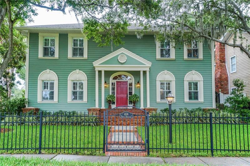This American Colonial-style home recalls those you might admire in Charleston or Savannah.  It offers a bright 2-story entry, formal living and dining rooms as well as a large family room with wet bar and wood burning fireplace. The open-concept kitchen features stainless appliances, ample granite work surfaces, a butler's pantry, plus an oversized breakfast area. A central full bath serves all lower-floor rooms. The large master suite includes an en suite pocket-doored room, perfect as a nursery or home office. The sky-lighted master bath has a walk-in spa shower and soaking tub with dual basins and ample storage. A second travertine-lined bath with European fixtures serves the other two bedrooms across the second floor gallery. A separate staircase leads to a spacious room over the garage for use as a 4th bedroom, studio or game/media room. Outside, enjoy the attractively landscaped and gated front lawn area plus the privacy fenced blue pebble-tech pool and patio entertainment spaces of the back yard. Conveniently located minutes from Tampa International Airport, Westshore Mall, a newly planned walk-to Publix, International Plaza, fine dining and top-rated public and private schools, and you can refresh yourself mornings or evenings with a quick walk to Tampa Bay.